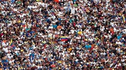 Opposition supporters take part in a rally against Venezuelan President Nicolas Maduro's government and to commemorate the 61st anniversary of the end of the dictatorship of Marcos Perez Jimenez in Caracas, Venezuela January 23, 2019. REUTERS/Carlos Garcia Rawlins